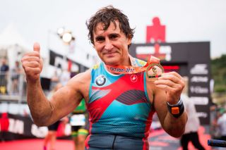 BARCELONA SPAIN SEPTEMBER 30 Former Formula One driver and paracyclist Alex Zanardi poses after finishing IRONMAN Barcelona on September 30 2017 in Calella Barcelona province Spain Photo by Alex CaparrosGetty Images for IRONMAN