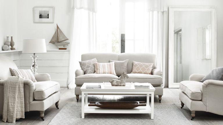 Light gray sofa in neutral living room by Neptune