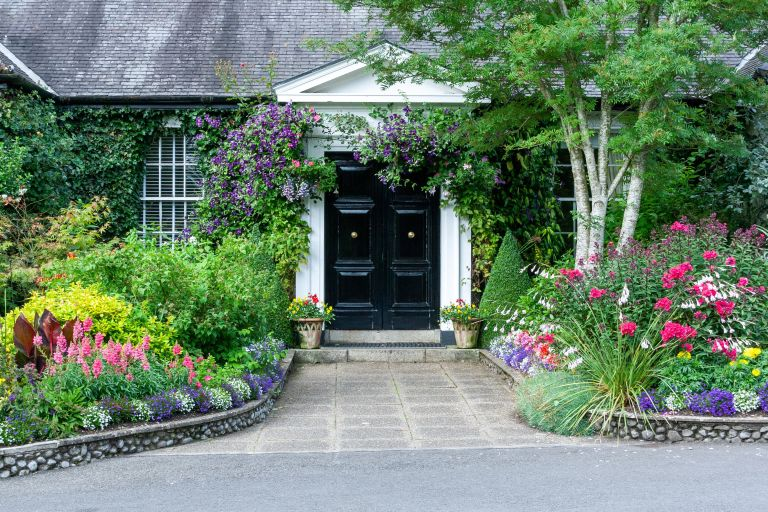 Front garden and driveway with colourful flowerbeds