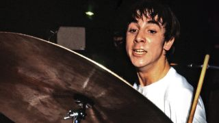 Close-up of a youthful Keith Moon, drummer with The Who, playing live in the 60s