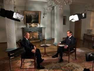 Chris Wallace and Vladimir Putin on Fox News Sunday