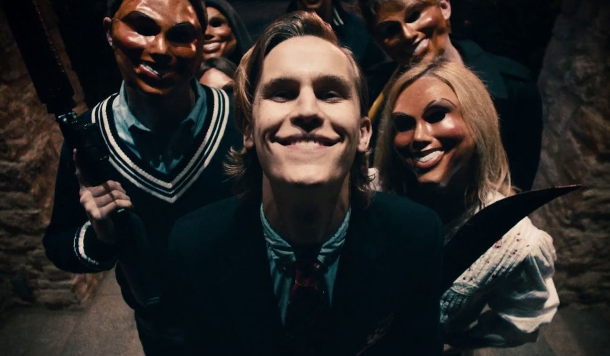 Rhys Wakefield smiles menacingly with his fellow Purgers in The Purge.