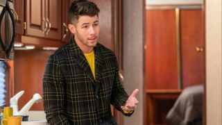 Nick Jonas offers some sage advice in front of a kitchen cabinet