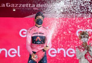 Filippo Ganna (Ineos) celebrates his third day in the maglia rosa