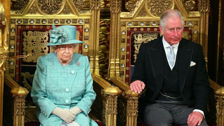 Queen Elizabeth II and her son Prince Charles, Prince of Wales sit in the House of Lords chamber during the State Opening of Parliament