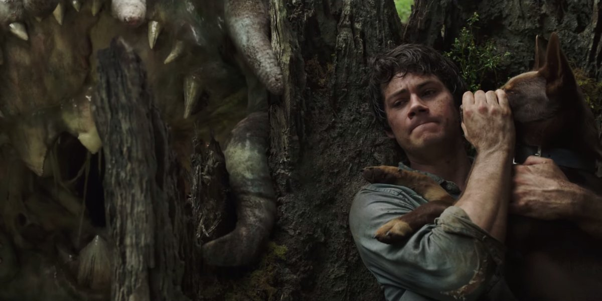 Love and Monsters Dylan O'Brien trying to keep his dog quiet near a monster