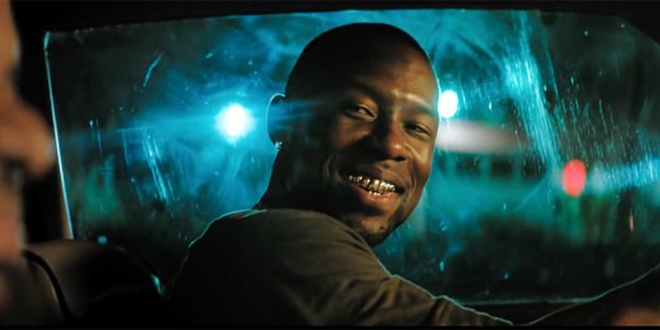 Trevante Rhodes Moonlight Smiling driving his car