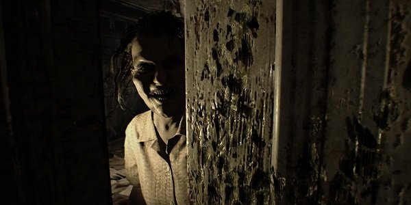 A spooky lady waits on the other side of the door in Resident Evil 7.