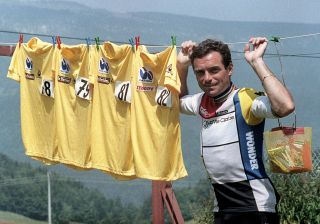 Frenchman Bernard Hinault the overall leader of the 72nd Tour de France displays during a dayoff on July 12 1985 in VillarddeLans his four yellow jerseys won in previous years 1978 1979 1981 1982 Hinault won the 1985 edition as well to tie the record set by his compatriot Jacques Anquetil and Belgian rider Eddy Merckx AFP PHOTO Photo credit should read AFP via Getty Images