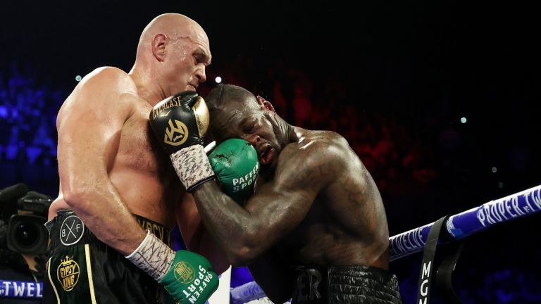 Tyson Fury (L) punches Deontay Wilder during their Heavyweight bout for Wilder's WBC and Fury's lineal heavyweight title on February 22, 2020