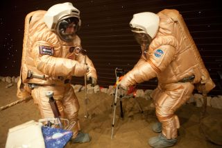 Crew training for 'Marswalk' at the simulated martian terrain of the Mars500 experiment. The terrain, about 10 m long and 6 m wide, is covered with reddish sand and is built to resemble the surface at Gusev crater. On the 'surface', they conducted simulat