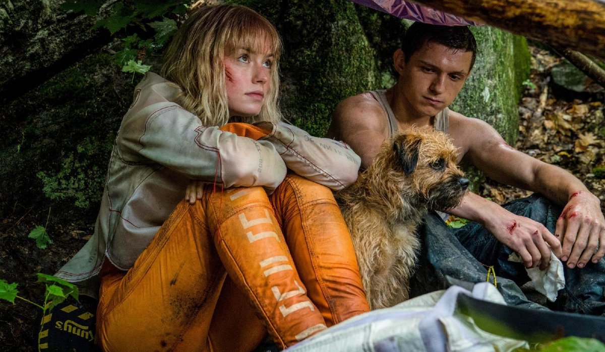 Daisy Ridley and Tom Holland find shelter with a dog in Chaos Walking.
