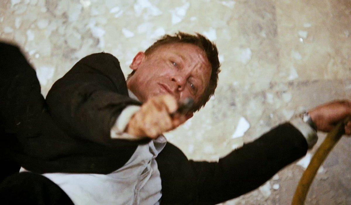 Quantum of Solace Daniel Craig aims his gun upward to fire