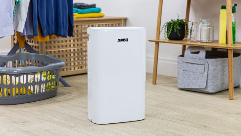 white dehumidifier in a utility room