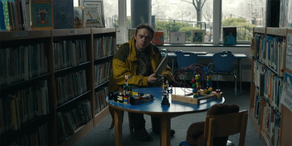 Dane DeHaan as Jim Dooley in the library in Lisey's Story