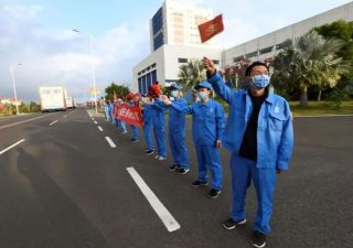 Masked employees welcome a Long March 5B rocket to the Wenchang spaceport in February 2020. The booster is scheduled to launch a Chinese orbiter and rover to Mars in July 2020.
