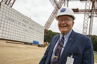 A photo of Fred Haise visiting NASA Langley historic gantry in 2019.