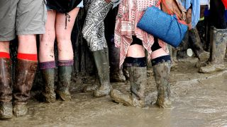 A picture of mud-covered music fans at Glastonbury festival 2016