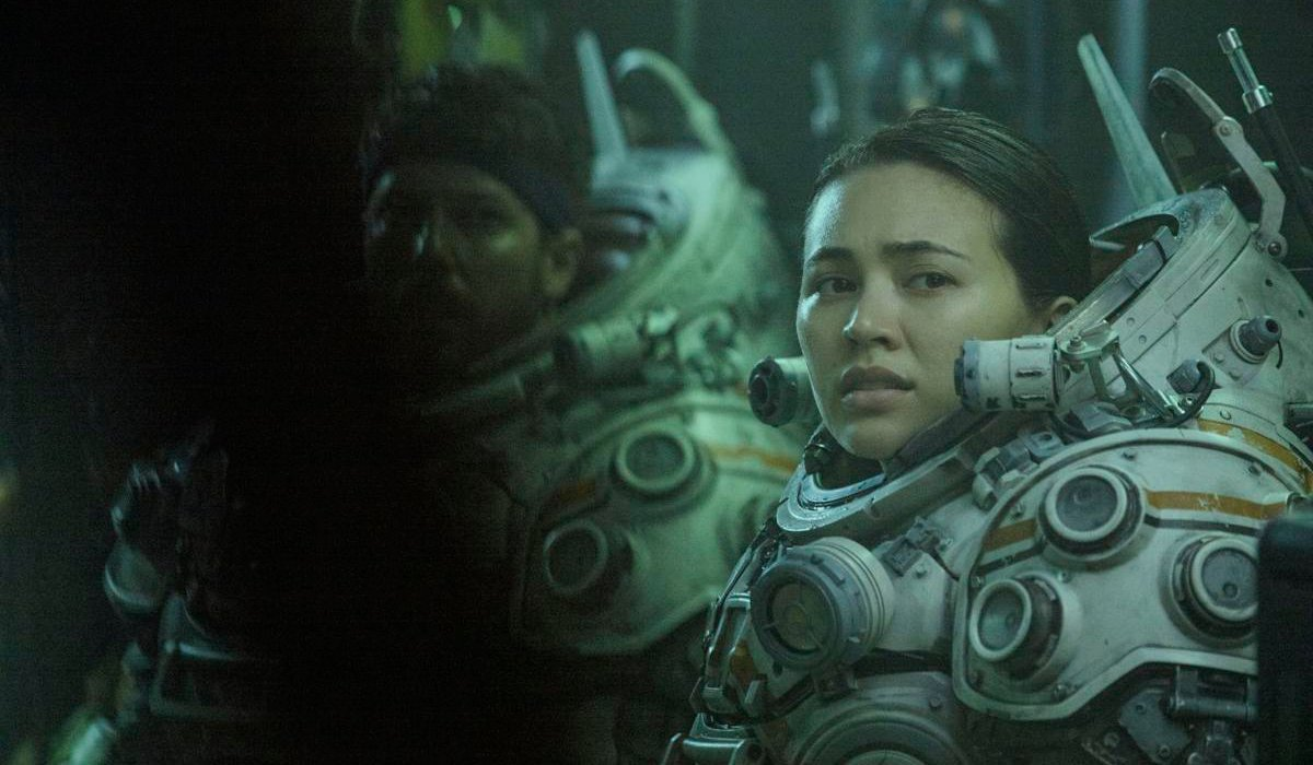 Underwater John Gallagher Jr and Jessica Henwick in their suits, minus helmets