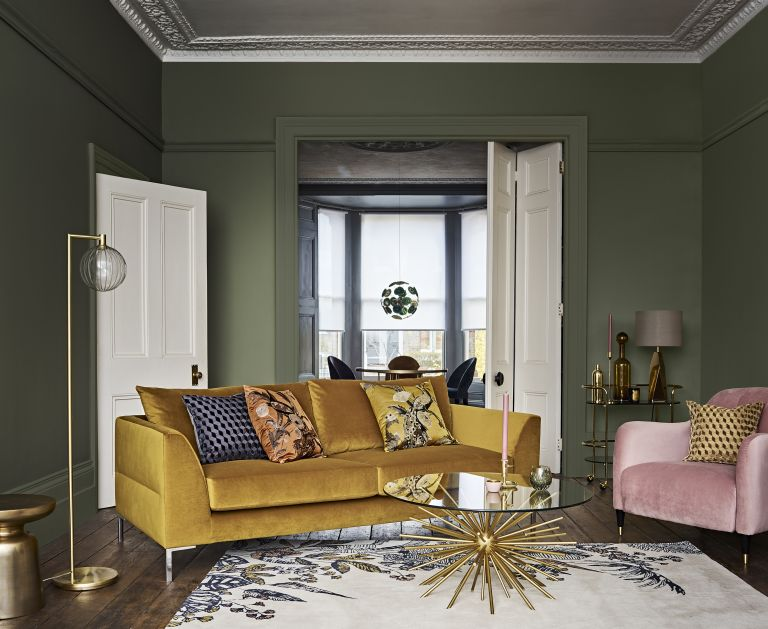 mustard yellow velvet sofa with Aquaclean in green living room