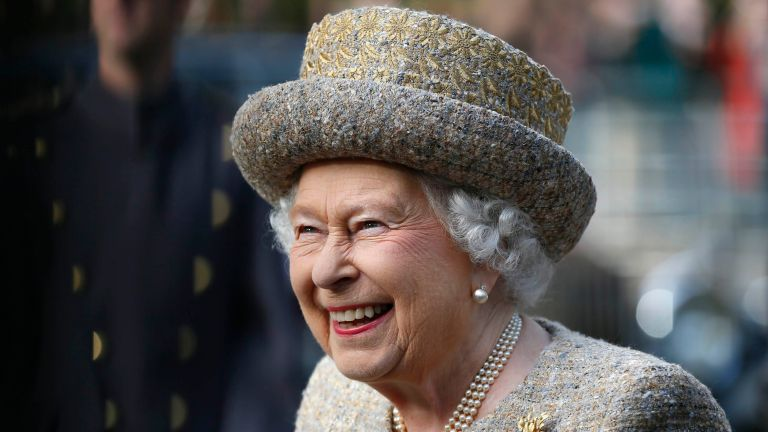 Queen Elizabeth II smiles as she arrives before the Opening of the Flanders' Fields Memorial Garden at Wellington Barracks on November 6, 2014 in London, England