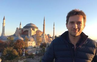 Programme Name: Ancient Invisible Cities - TX: n/a - Episode: Istanbul (No. Istanbul) - Picture Shows: in front of the Hagia Sophia, Istanbul. Michael Scott - (C) BBC Studios - Photographer: Renny Bartlett