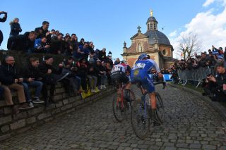 NINOVE BELGIUM FEBRUARY 29 Jasper Stuyven of Belgium and Team Trek Segafredo Yves Lampaert of Belgium and Team Deceuninck QuickStep Wall of Geraardsbergen De Muur Kapelmuur Fans Public Cobblestones during the 75th Omloop Het Nieuwsblad 2020 Men Race a 200km race from Ghent to Ninove OmloopHNB OHN20 on February 29 2020 in Ninove Belgium Photo by Tim de WaeleGetty Images