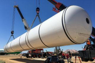 One of two solid rocket motors for the California Science Center's planned vertical display of space shuttle Endeavour is offloaded at Mojave Air and Space Port after being delivered from Northrop Grumman's test facility in Utah.