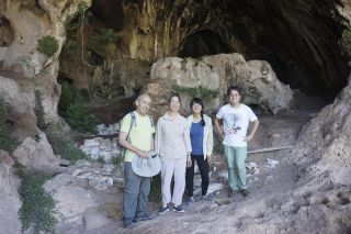 Standing in the entrance to Raqefet Cave, where they found evidence for the oldest man-made alcohol in the world, are, from left, Dani Nadel, Li Liu, Jiajing Wang and Hao Zhao.