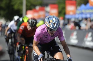 Skylar Schneider (L39ION of Los Angeles) in pink leader's jersey during stage 4 criterium at Joe Martin Stage Race