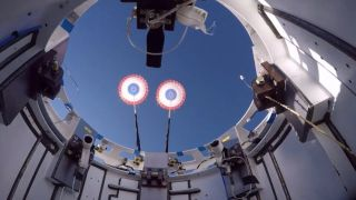 Two drogue parachutes successfully deploy from a Boeing Starliner test article during a landing system reliability test conducted on June 21, 2020, above White Sands Space Harbor in New Mexico.