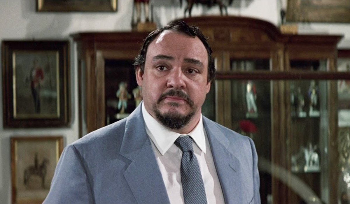 John Rhys-Davies listens intently in the study in The Living Daylights
