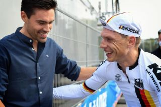 Tony Martin (Germany, on right) talks with Jumbo-Visma teammate Tom Dumoulin (Netherlands) at 2021 UCI Road World Championships after time trial