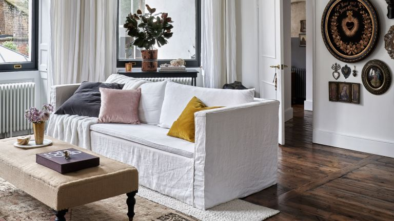 Neutral living room with white sofa