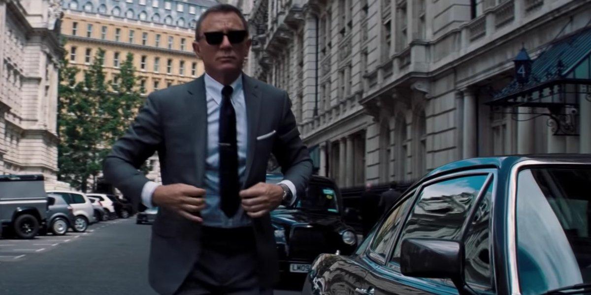 No Time To Die Daniel Craig walks in a sharp grey suit