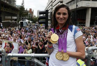 Britains quadruple gold medalwinning cyclist Sarah Storey poses during a parade celebrating Britains athletes who competed in the London 2012 Olympic and Paralympic Games in central London on September 10 2012 Britain was bidding a fond farewell om September 10 to a golden summer of Olympic and Paralympic sport with a victory parade by athletes through London ending up at Buckingham Palace AFP PHOTO POOL STEFAN WERMUTH Photo credit should read STEFAN WERMUTHAFPGettyImages