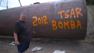 "Big Al is featured on the second season of ""Doomsday Preppers"" and fears that the Russians might send a nuclear missile toward the U.S. at any moment. Here he is photographed with a spent fuel tank made of thick metal (good for blocking gamma rays from an"
