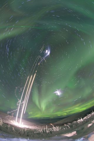 Four Rockets Launch with Aurora