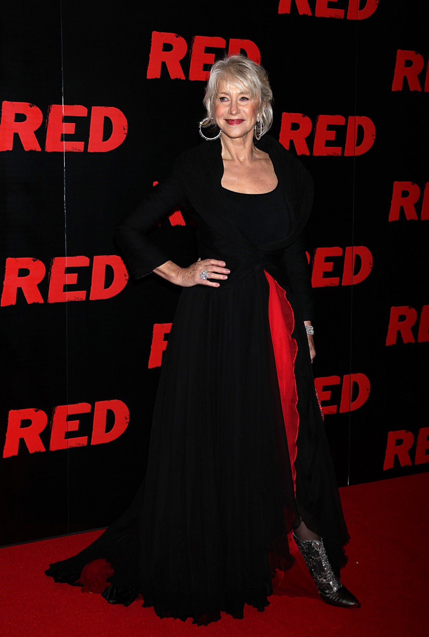 Helen Mirren strikes a pose a the premiere if Red in 2010