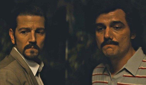 Diego Luna as Felix Gallardo and  Wagner Moura as Pablo Escobar on Narcos: Mexico