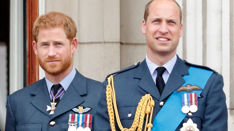 Prince William and Prince Harry watch a flypast to mark the centenary of the Royal Air Force from the balcony of Buckingham Palace