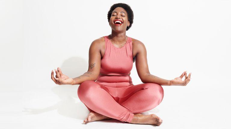 Woman wearing sportswear practicing laughter yoga