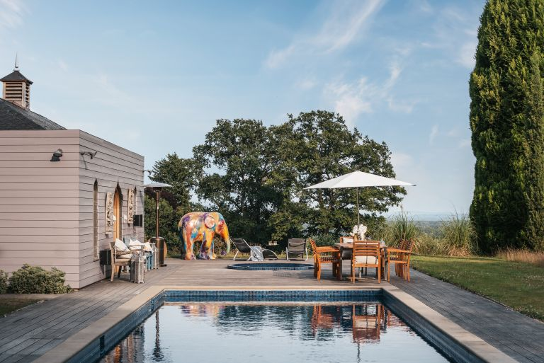Pool house with dining table and decking