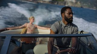 John David Washington and Elizabeth Debicki in Tenet.