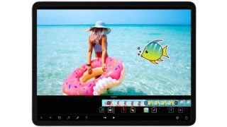 Best video editing apps: iPad showing girl carrying rubber ring into sea