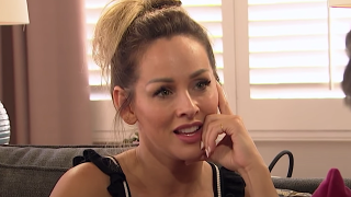 The Bachelorette Clare Crawley touches her face while talking