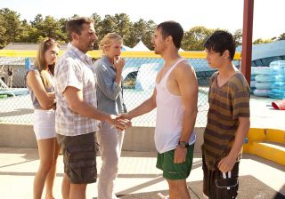 Steve Carell and Toni Collette greet a soaking wet Sam Rockwell and Liam James