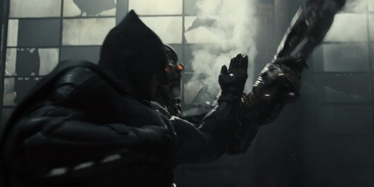 Ben Affleck as Batman fighting a Parademon in Zack Snyder's Justice League