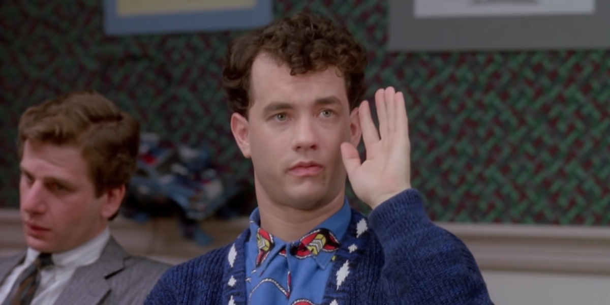 Tom Hanks raising his hand in Big