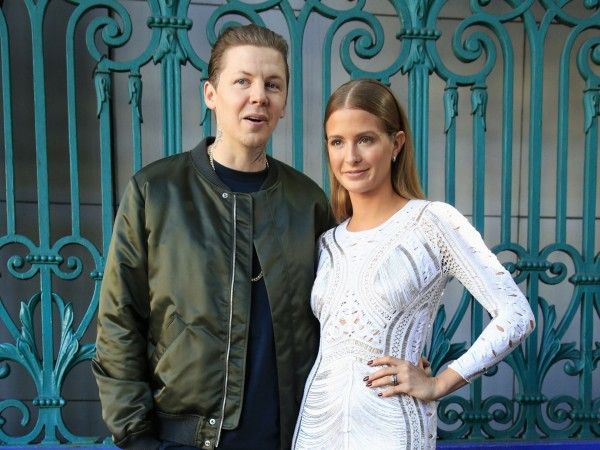 Professor Green and Millie Mackintosh poses for photographers before the Julien Macdonald Spring/Summer 2016 London Fashion Week show at Smithfield Market, London.